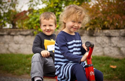 boy and girl on bike